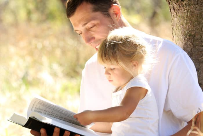 dad and child with bible