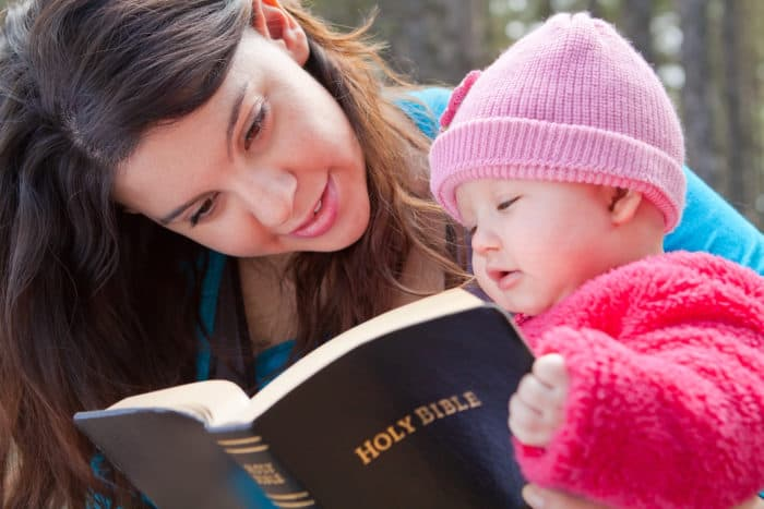 mom and baby with bible