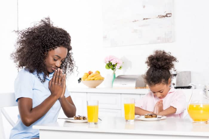 mom and daughter praying